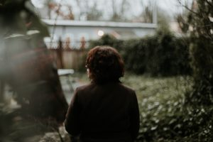woman looking out in her garden feeling symptoms of anxiety and depression in need of psychologist near Thousand Oaks, ca