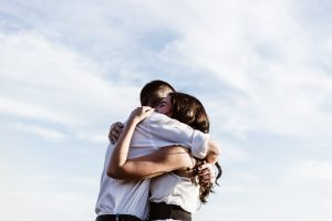 Couple hugging after making up due to constant fighting in need of marriage counseling Simi Valley, Ca