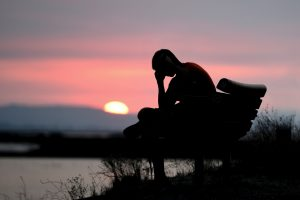 Man feeling symptoms of depression including irritability, sadness, and crying spells in need of psychologist near Thousand Oaks, Ca