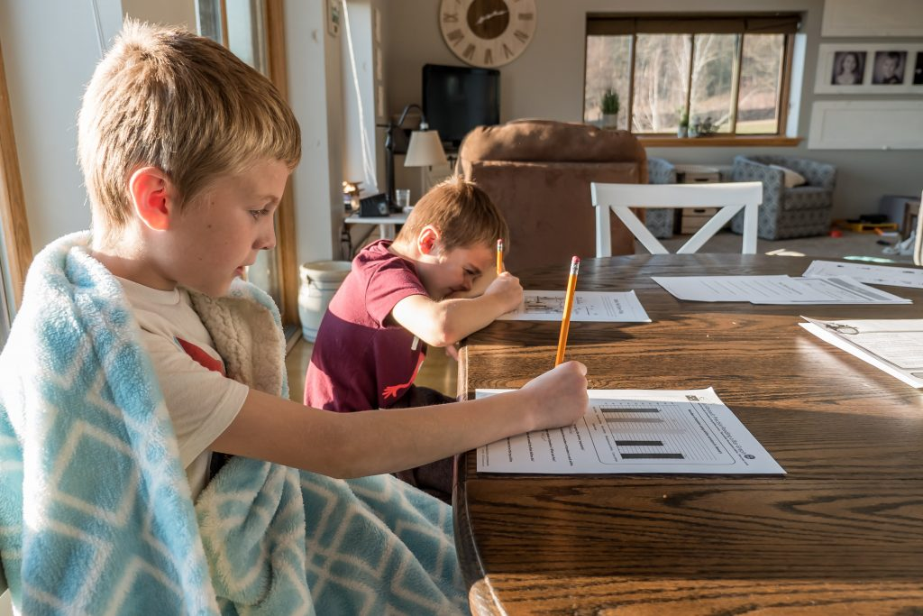 child working on homework and is getting frustrated but parents are able to help due to child therapy Simi Valley, Ca by child psychologist near Thousand Oaks, Ca