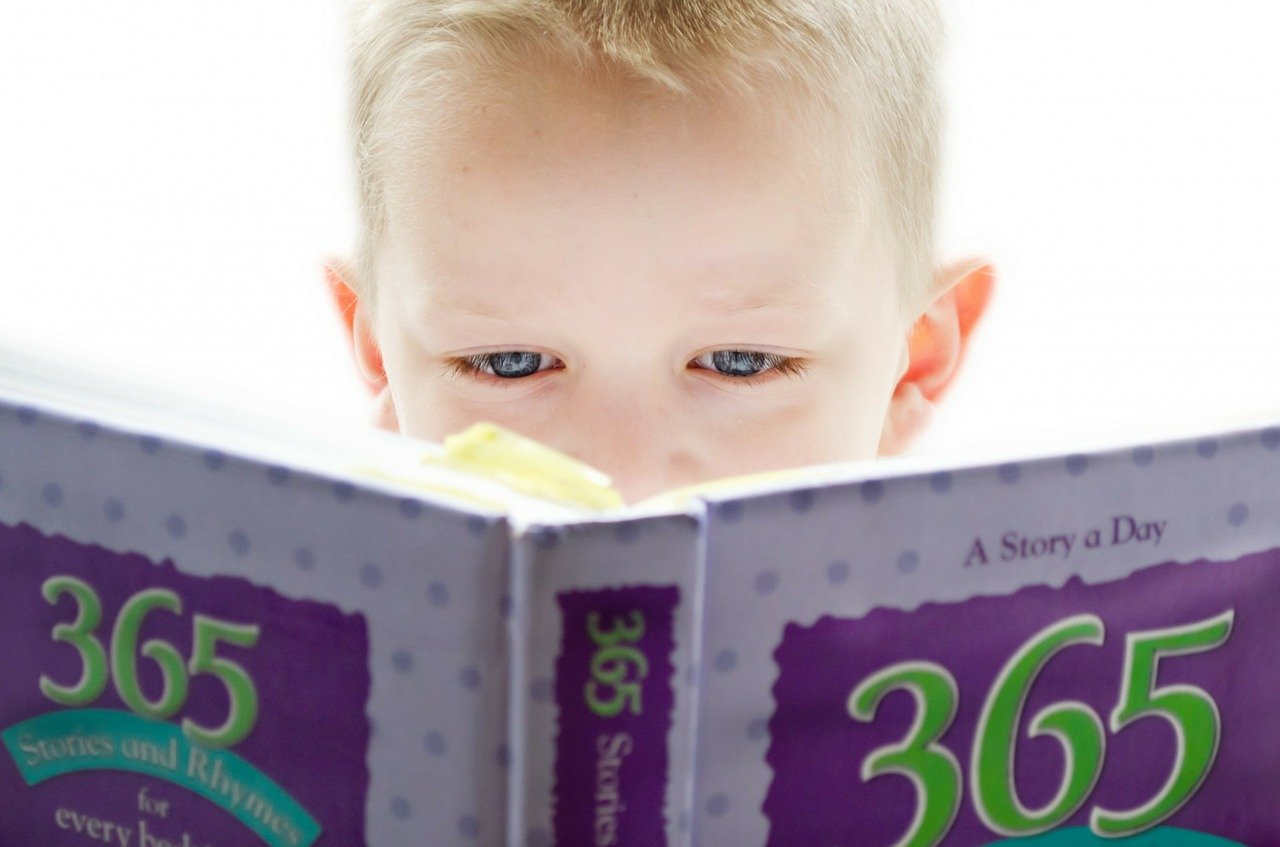 Boy reading a book in need of child psychologist to do psychological evaluation Thousand Oaks, Ca