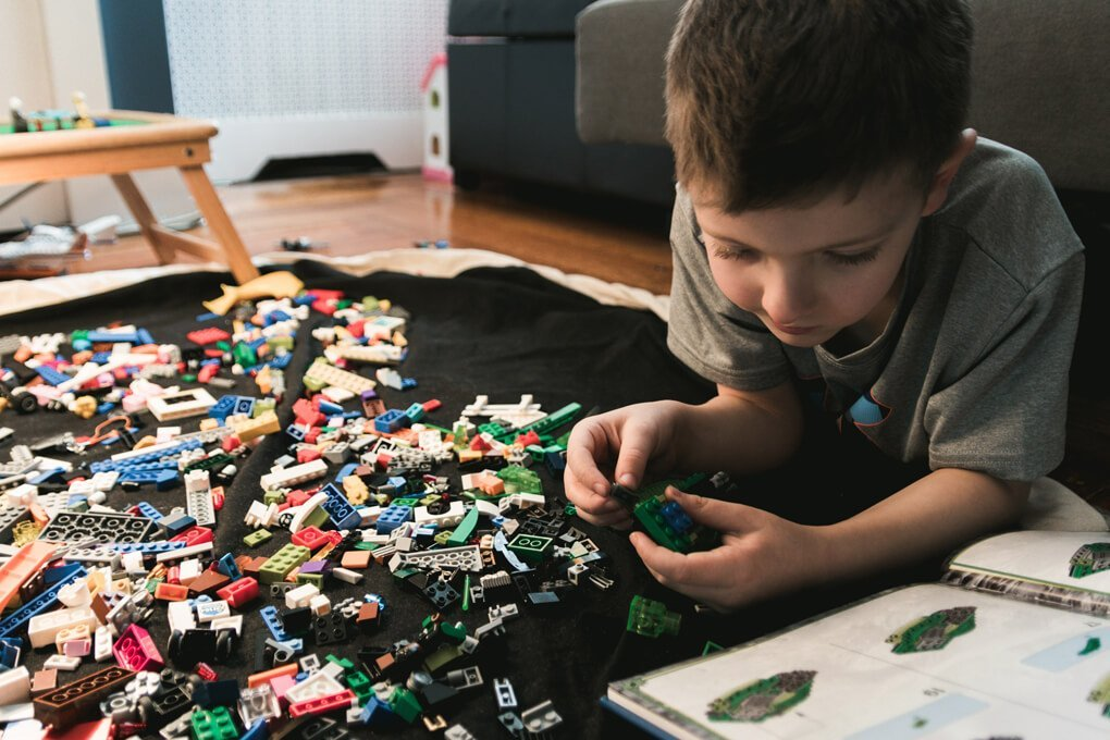 Boy with impulsivity playing with lego after getting help with ADHD test in Simi Valley, Ca