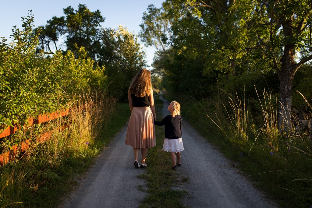 Mom and daughter going on a walk in need of support during Coronavirus in need of Online Therapy in the LA area
