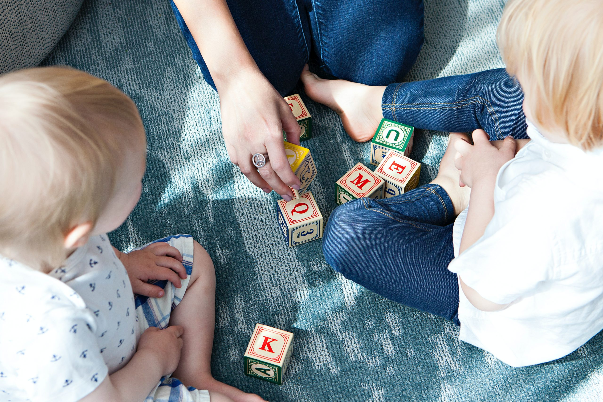 Children playing with letter blocks and having some trouble reading in need of dyslexia testing near Thousand Oaks, Ca