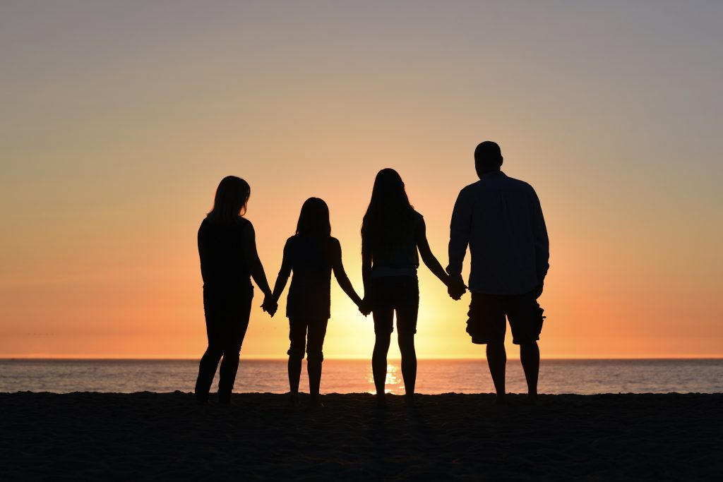 Family enjoying the sunset in need of child psychologist for family counseling in Simi Valley