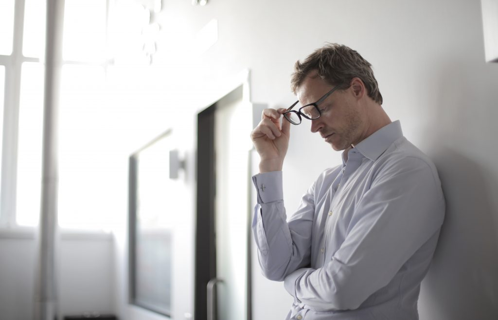 Man is struggling with social anxiety in the workplace in need of social anxiety counseling Moorpark, Ca