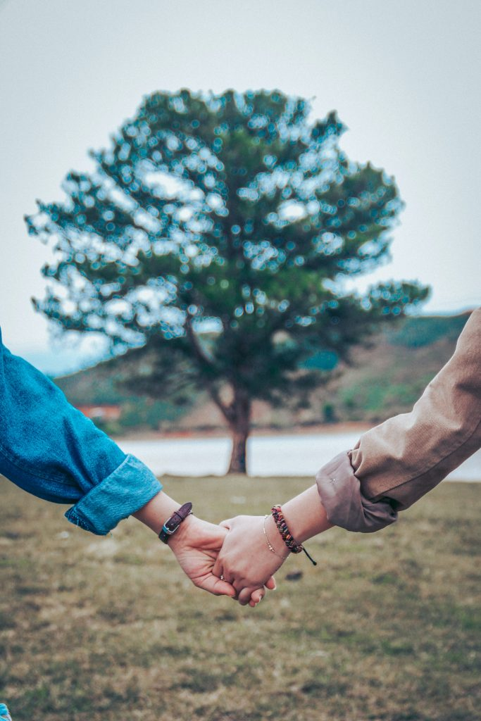 Couple holding hands valuing their marriage in marriage counseling near Thousand Oaks, Ca