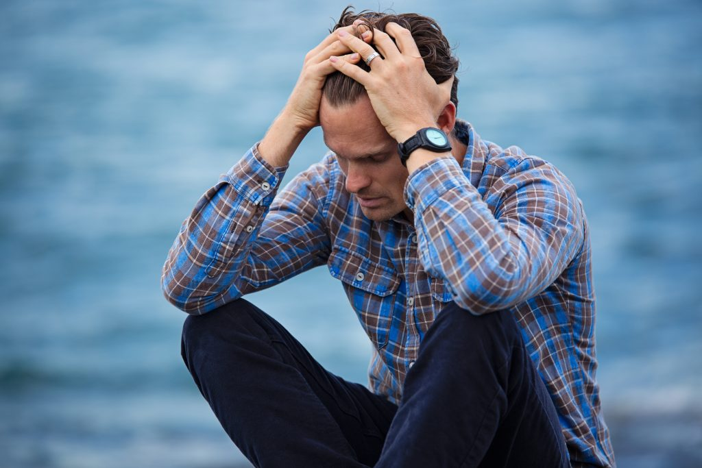 Man is showing signs of depression including headaches and sad mood in need of depression therapy in Simi Valley, Ca