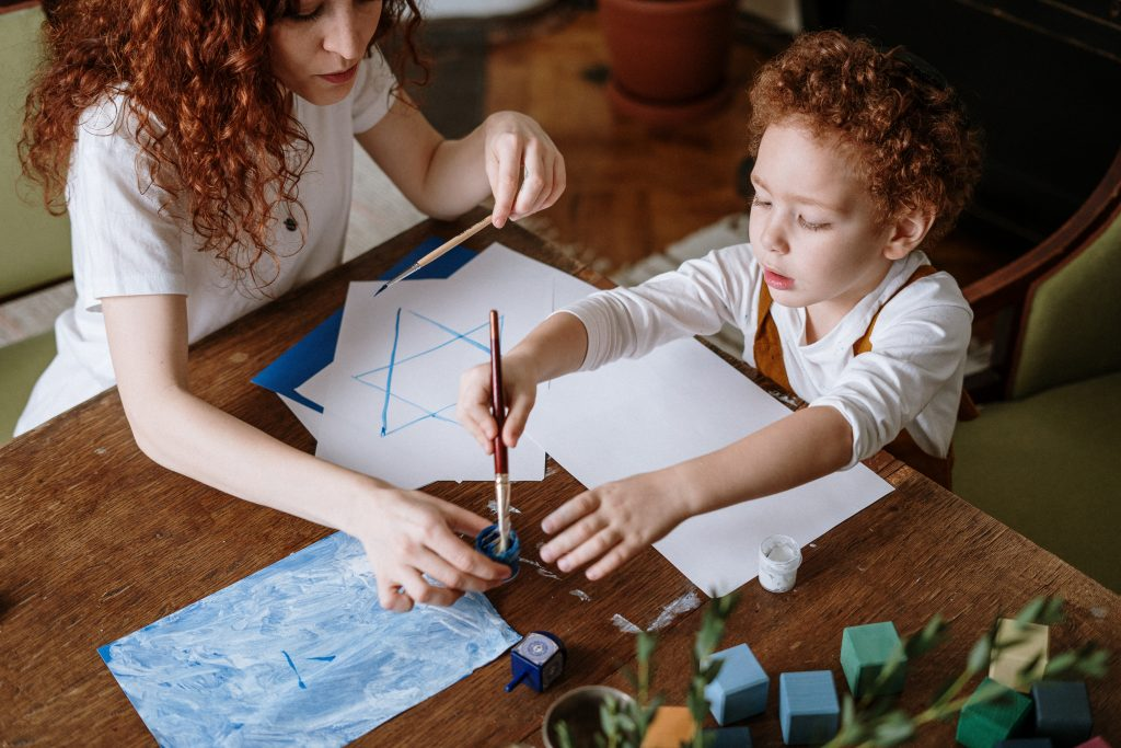 Woman and son are drawing a picture together and mom is wanting to learn how to be more patient with her kids. Child therapy in Simi Valley, Ca
