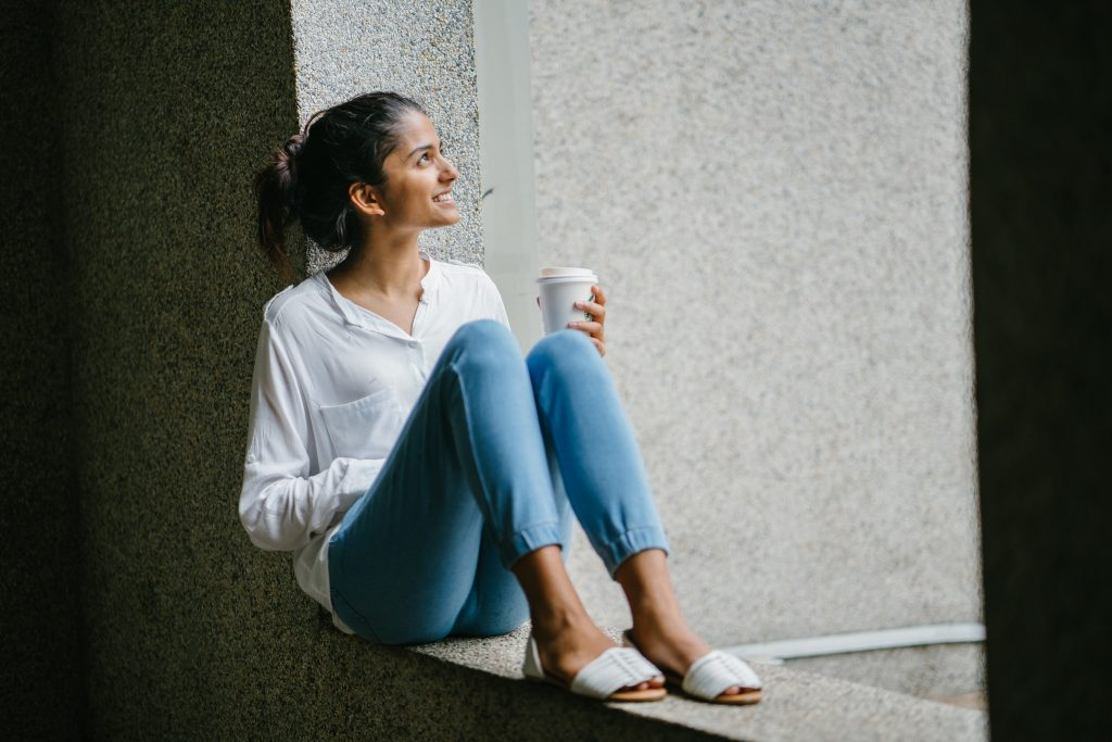 Woman is drinking coffee thinking about her values in life after online therapy Los Angeles