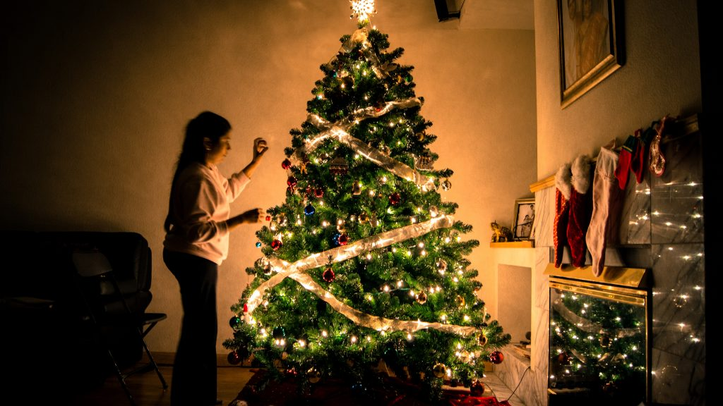 Woman decorating tree after conflict in need of online therapy in the LA area