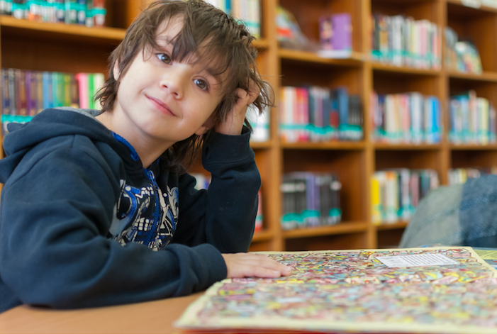 young boy enjoying playing a puzzle and working through a hard feeling of stress